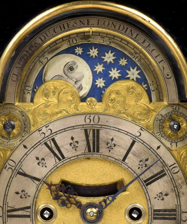 CLAUDIUS DU CHESNE LONDINI FECIT. AN EXCEPTIONAL SEMI-MINIATURE GEORGE I PERIOD EBONISED AND BRASS MOULDED MOONPHASE TABLE CLOCK BY THIS WELL-KNOWN HUGUENOT MAKER.