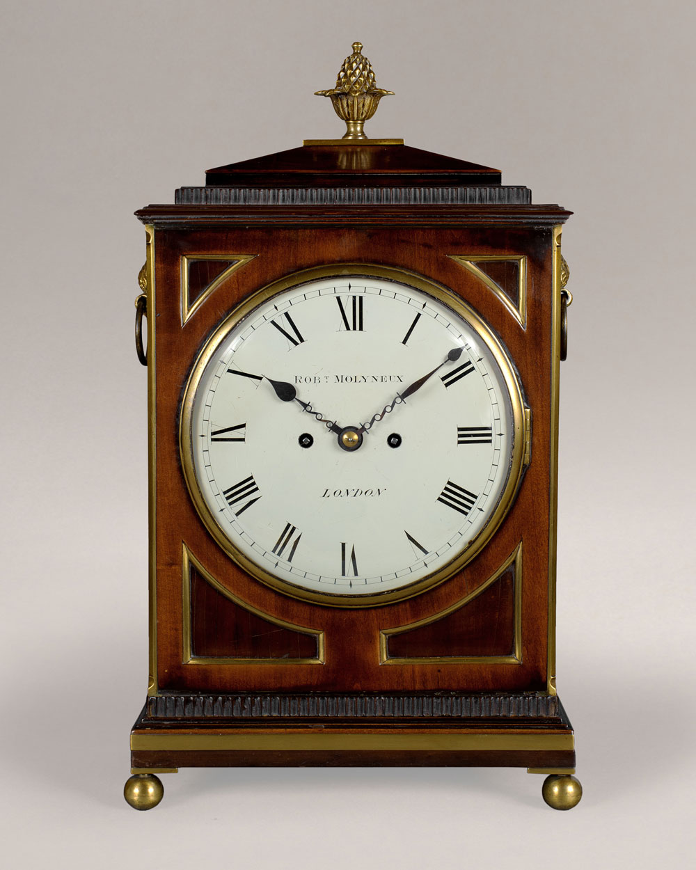 ROBERT MOLYNEUX. A good late Regency ebonised pearwood bracket clock
