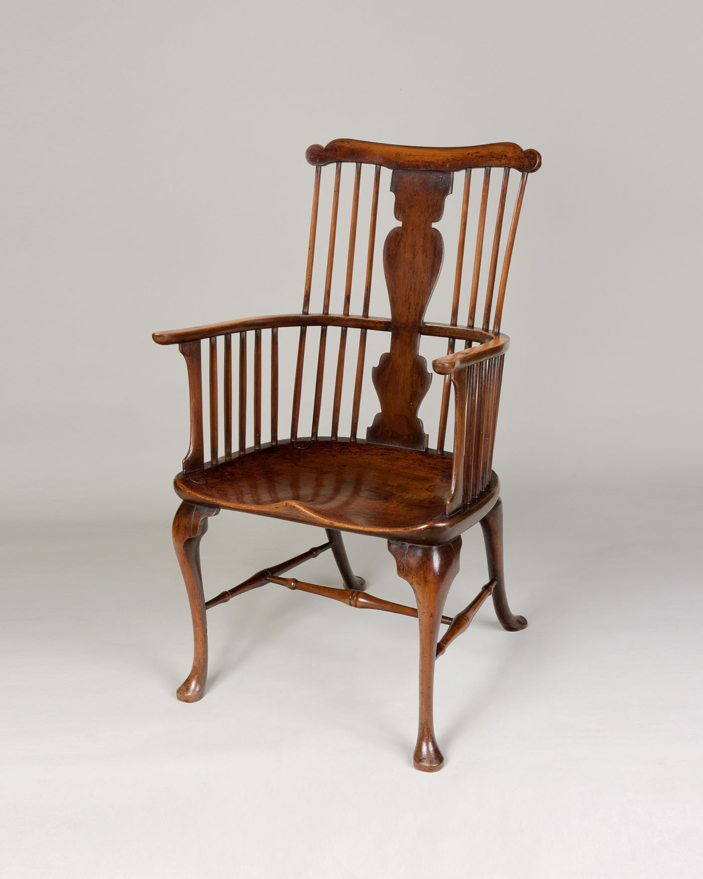 GEORGE III PERIOD WINDSOR CHAIR.  rare walnut and sycamore comb-back Thames Valley Windsor chair