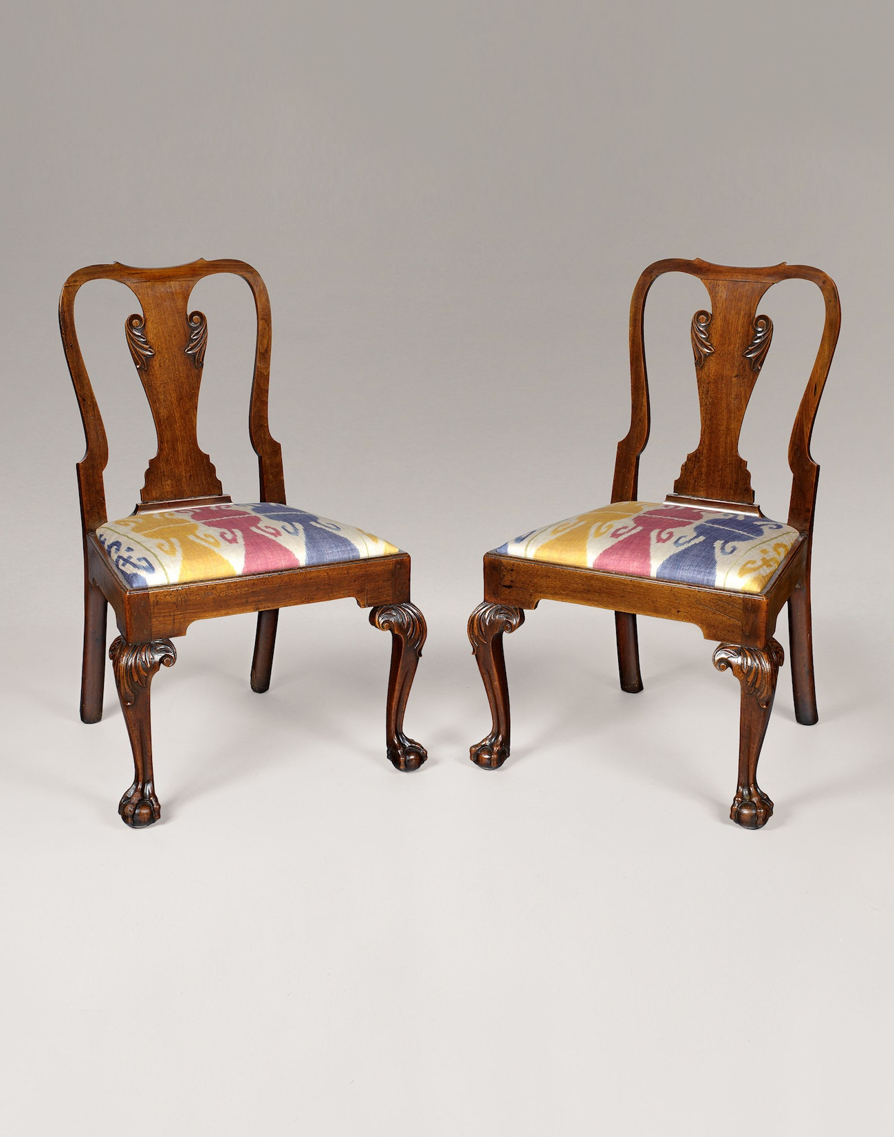 PAIR OF GEORGE II CARVED MAHOGANY CHAIRS.